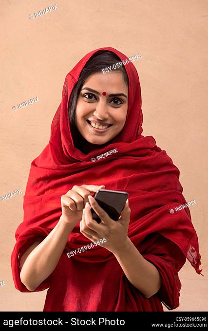 Portrait of a woman working on her mobile phone