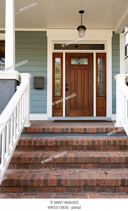 Brick steps and front door of house
