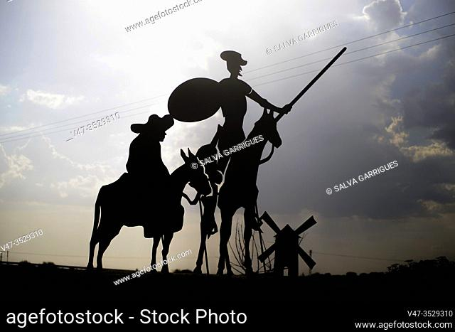 silhouette of a sculpture of Don Quixote de la Mancha, Sancho Panza and a photographer