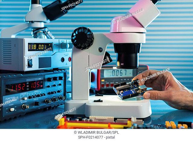 Examining circuit board with microscope