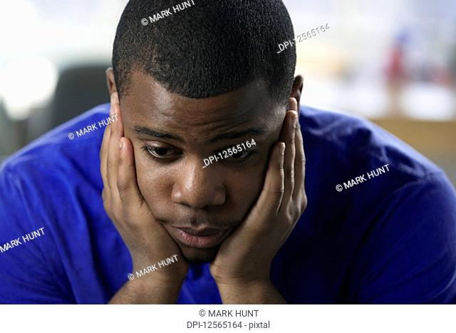 Close up of a depressed young man