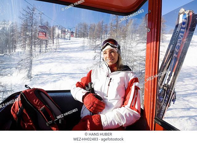 Austria, Salzburger Land, Altenmarkt- Zauchensee, Young woman in Aerial Tram