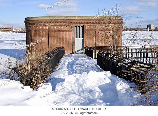 A historic and still functioning water pumping station of the art deco style on the Detroit River along Riverfront Park, Windsor, Ontario, Canada