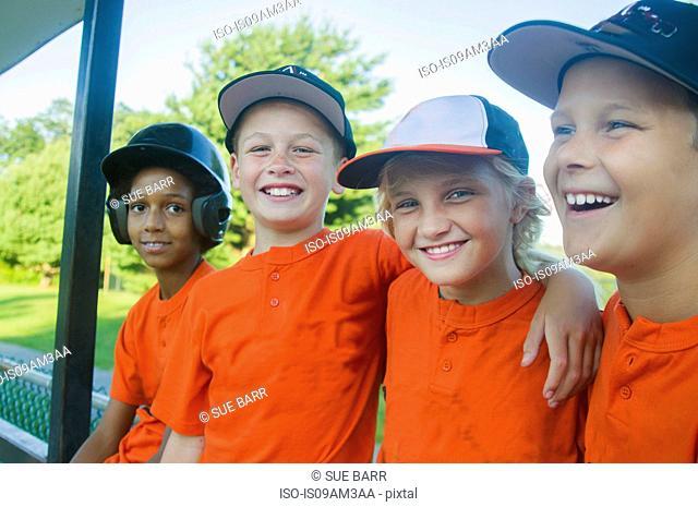 Young baseball players waiting to play