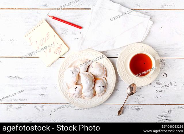 Breakfast with tea, flat lay, white light color