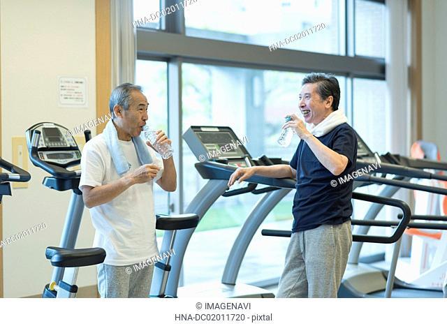 Senior man pausing at gym