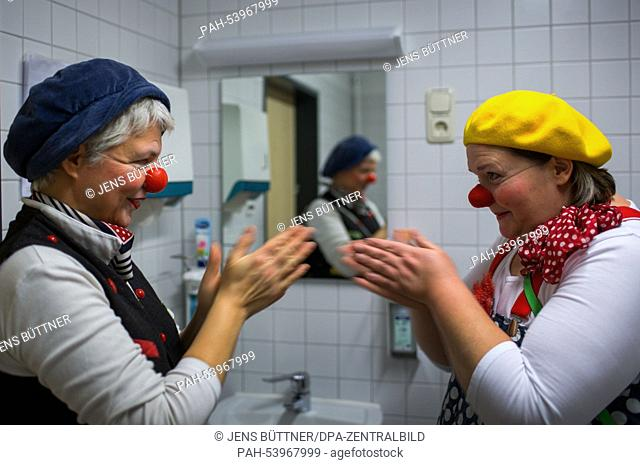 """Kerstin Daum as """"""""Kiki"""""""" (R) and Ines Vowinkel as """"""""Fine"""""""" (L) prepare to visit a patient at the children's station at the Helios Clinic in Schwerin, Germany"""