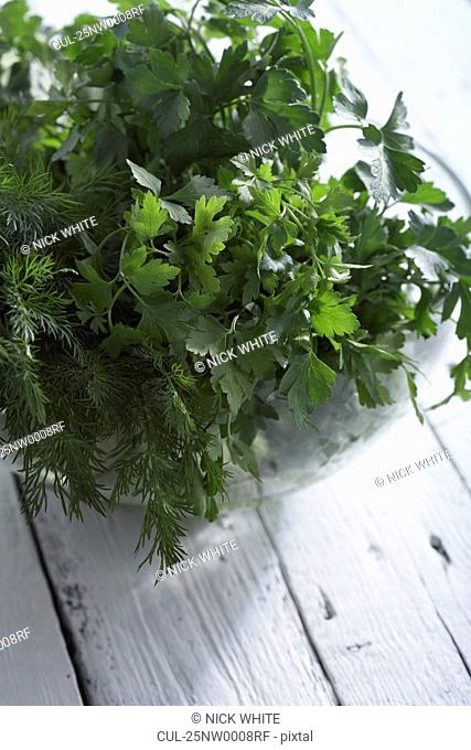 Collection of herbs on white table