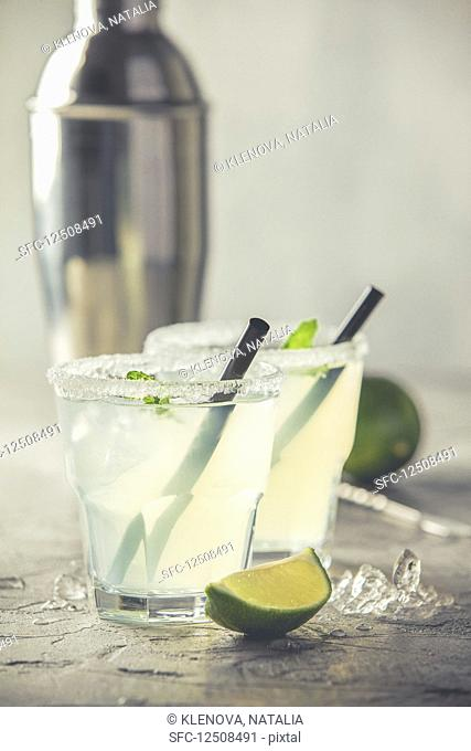 Refreshing summer alcoholic cocktail margarita with crushed ice and citrus fruits
