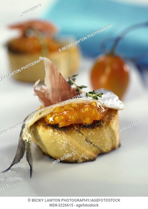 montadito de boquerones en vinagre con jamon iberico / montadito of anchovies in vinegar with iberian ham