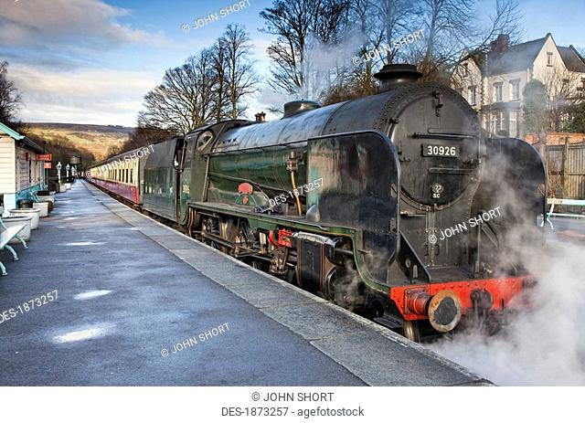 grosmont, north yorkshire, england, steam from a train along the tracks at a station