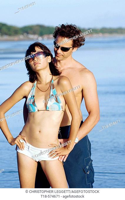 couple posing on beach