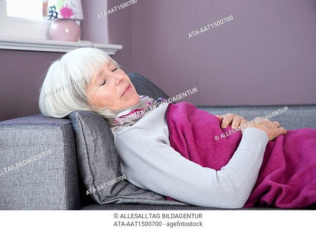 Elderly woman taking a nap