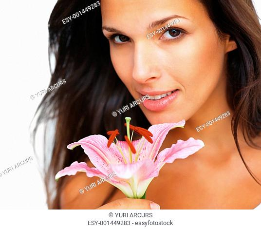 Head shot of pretty woman holding a flower towards camera