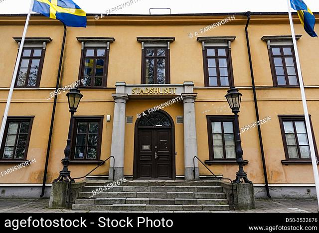 Norrkoping, Sweden The facade of the old city hall and Swedish flags