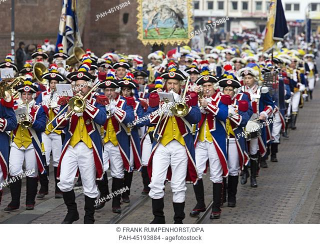 Musicians of the 'Mainzer Garden' (lit. Mainz guards) wearing carnival uniforms parade through the city in Mainz, Germany, 01 January 2014