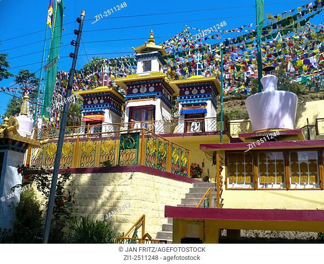 colourful praying flags and stupa at tsuglagkhang monastery in dharamsala, india