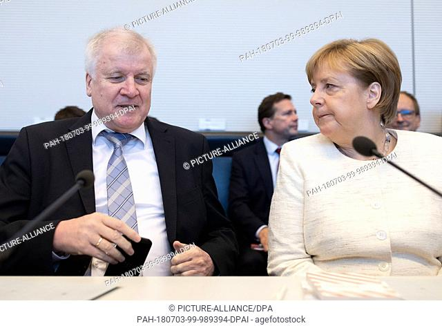 03 July 2018, Germany, Berlin: Minister for Domestic Affairs and Infrastructure from the Christian Social Union (CSU), Horst Seehofer (L)