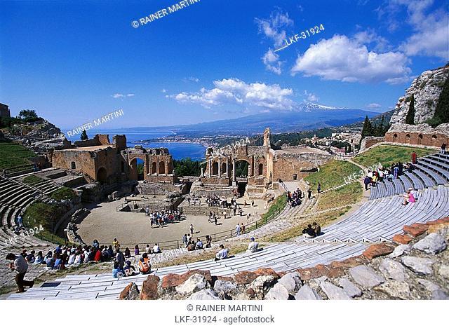 Tourists at Theatro Greco under blue sky, Taormina, Sicily, Italy, Europe