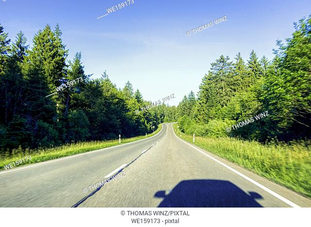 Driving on highway B500 in the Black Forest Rgion, Shadow of the car and rearview mirrors, Freudenstadt, Baden Württemberg, Germany