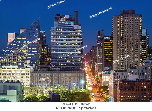 USA, New York, New York City, Mid-Town Manhattan, elevated city skyline from the west, dusk