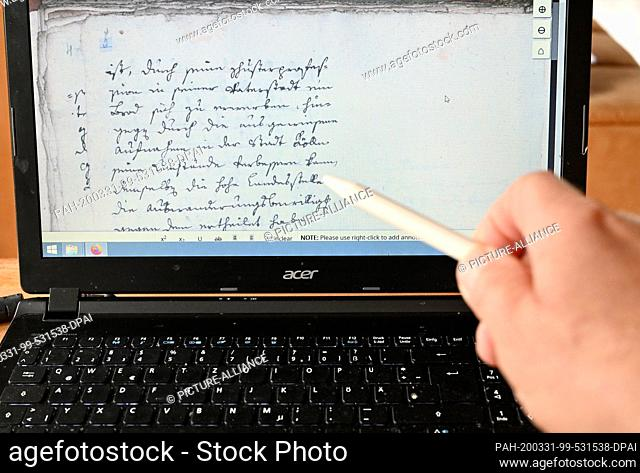 ILLUSTRATION - 30 March 2020, Schleswig-Holstein, Lübeck: A historical document from the time of the Hanseatic League can be seen on the screen of a computer