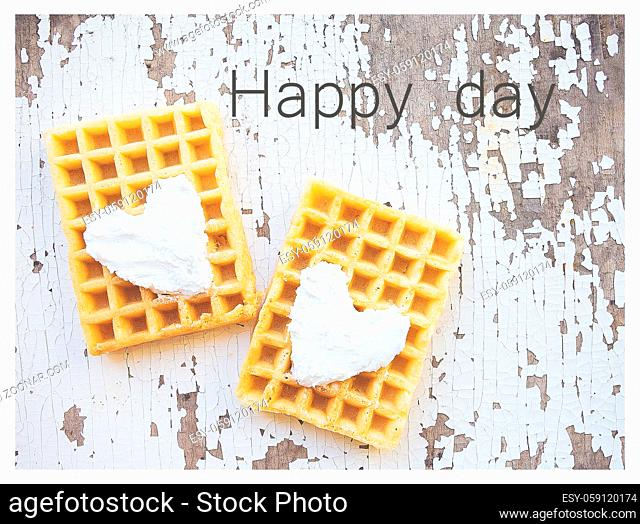 Very beautiful Belgian waffles on an old table-an inscription of a happy day