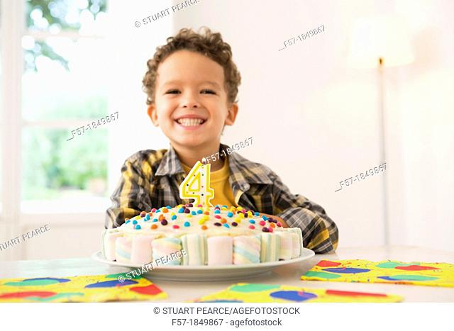 Four year old boy celebrating his birthday