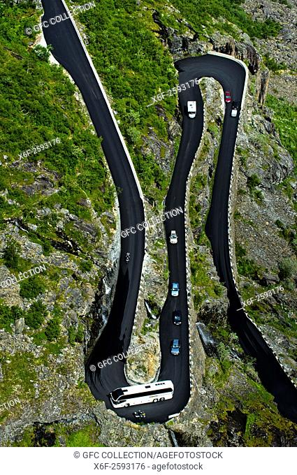 Coach in a narrow hairpin bend of the Trollstigen mountain road near Andalsnes, Rauma Municipality, Møre og Romsdal county, Norway