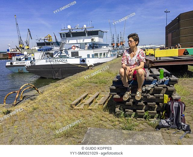 Merwehaven, Rotterdam. Taking a break on a stack of pallets during a harbour stroll