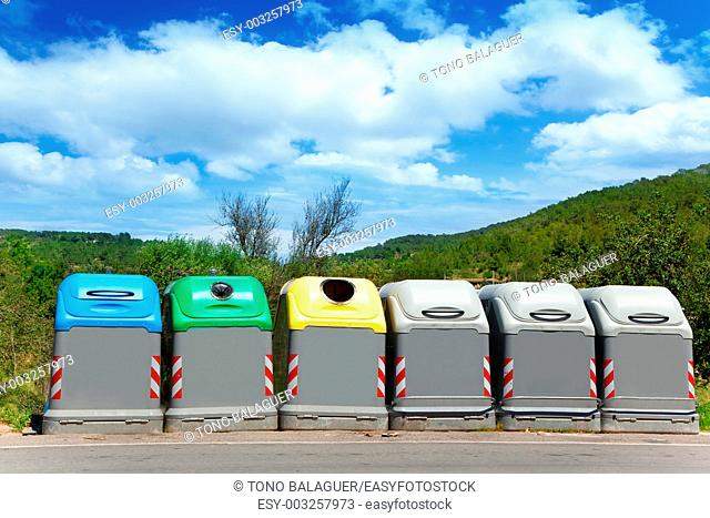 Ecologic selective trash containers by colors for a green planet concept