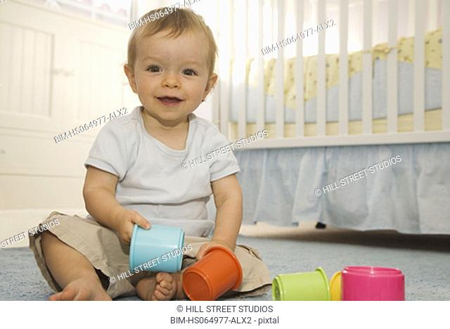 Portrait of baby playing on floor