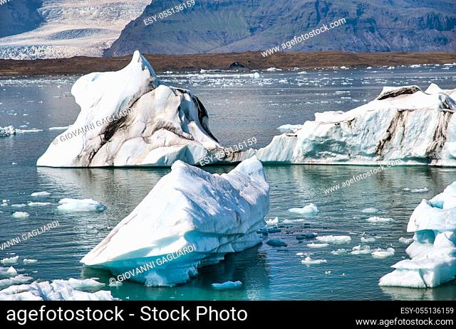 Iceland, Europe. Glacier ice floating on the water with snow at Jokulsarlon glacier lagoon in the winter time