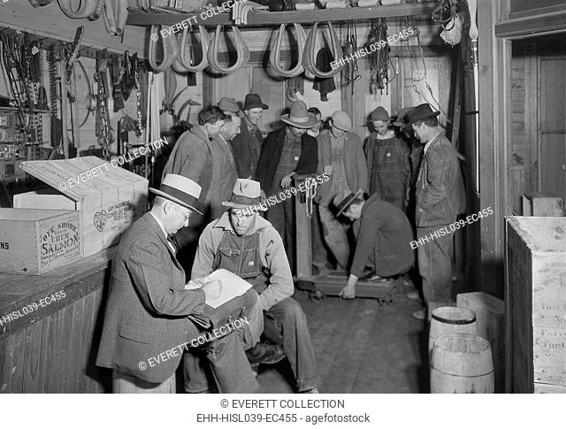 Applicants for jobs on TVA's Norris Dam were conducted at Stiner's Store, Lead Mine Bend, TN. In the background, other applicants amuse themselves by seeing who...