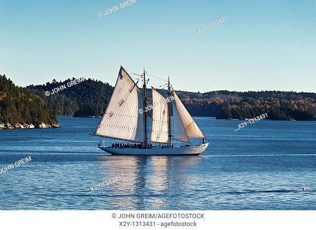 Yacht sailing off coast of Castine, Maine, ME, USA