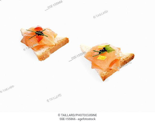 White bread triangles with smoked salmon