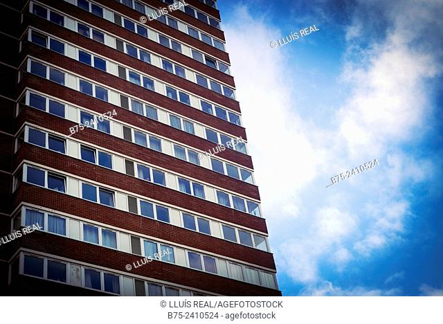 Facade with windows of an apartment building with blue sky and clouds in Tower Hamlets, East End, London, England, UK, Europe