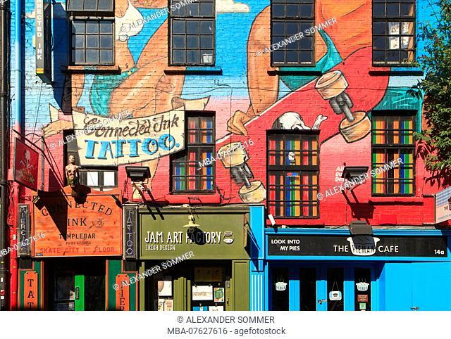 Artistic graffitis on the house facade in Dublin, Ireland