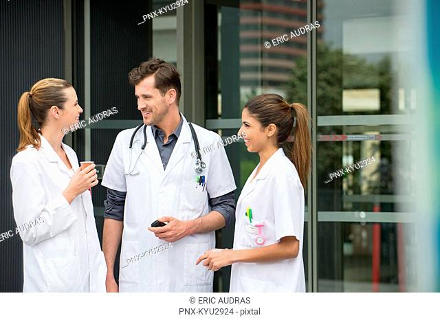 Doctors talking to each other