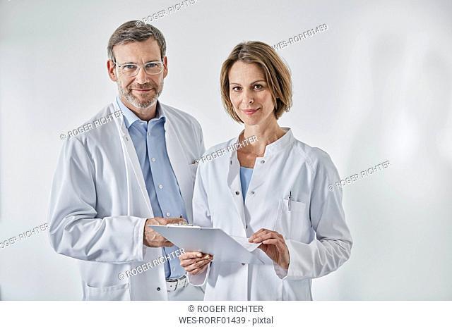 Portrait of doctors with anamnesis questionnaire