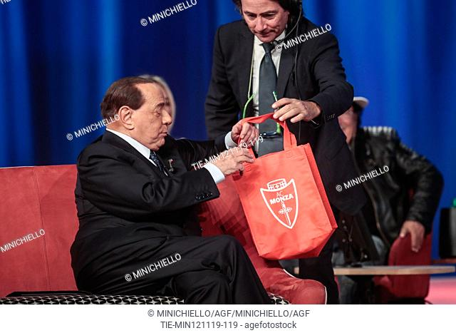 AC Monza President Silvio Berlusconi, during the recording of tv program 'Maurizio Costanzo Show' gives a t-shirt of the Monza soccer team to the journalist...