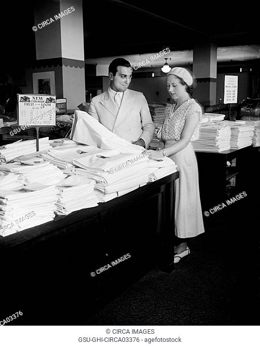 Salesman Helping Customer with Linens, Harris & Ewing, 1933
