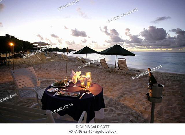 Romantic candlelit meal on the beach
