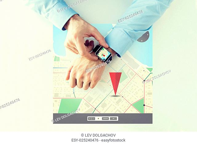 business, technology, navigation, location and people concept - close up of male hands setting smart watch with gps navigator map on screen
