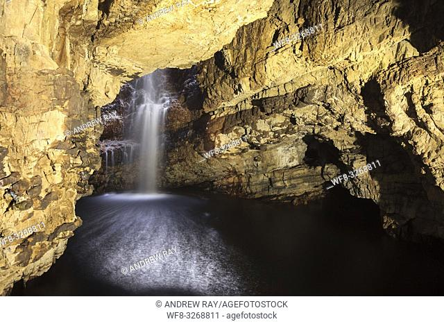 Smoo Cave Waterfall in a cave at Durness in the far North West of Scotland