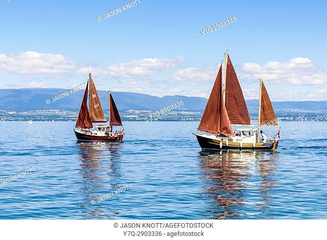 Traditional sailing boats on Lake Geneva, off the shore of Évian-les-Bains, Haute-Savoie, Auvergne-Rhône-Alpes, France