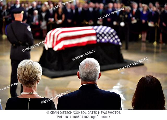 Vice President of the United Staes Mike Pence and wife Karen Pence view the casket of former Senator John McCain in the Capitol Rotunda where he will lie in...