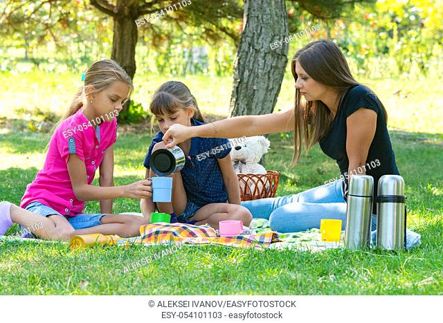 Family tea party on a lawn picnic