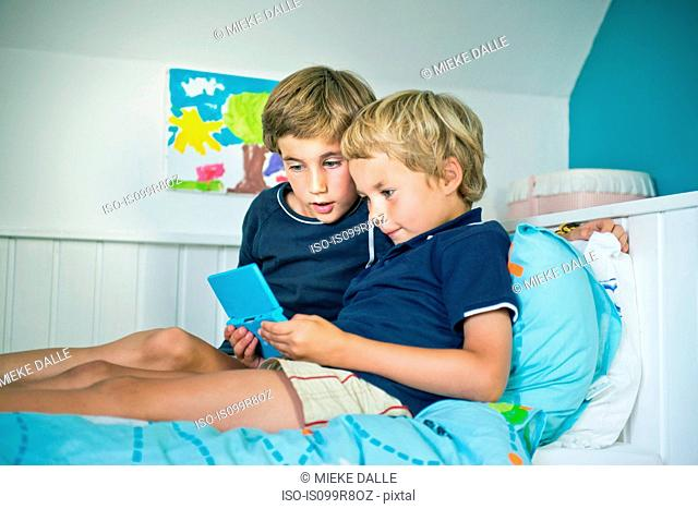 Brothers with handheld computer game