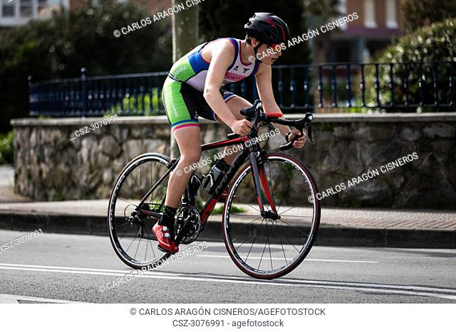 CASTRO URDIALES, SPAIN - APRIL 22, 2018: Unidentified athlete in the cycling competition during the III Duathlon Triflavi of Castro Urdiales